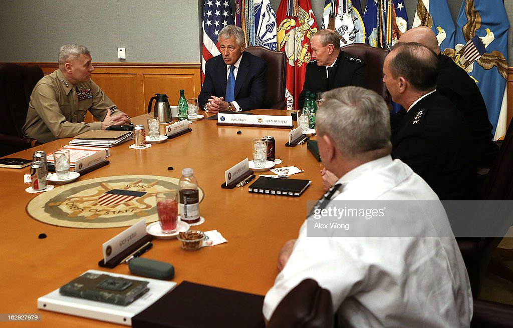 U.S. Secretary of Defense Chuck Hagel (2nd L) meets with (L-R) Marine Corps Assistant Commandant General John Paxton, Chairman of the Joint Chiefs of Staff General Martin Dempsey, Army Chief of Staff General Raymond Odierno, Chief of Naval Operations Admiral Jonathan Greenert, and Chief of the National Guard Bureau General Frank Grass at the Joint Chiefs Conference Room, also known as the 'tank,' March 1, 2013 at the Pentagon in Arlington, Virginia. Secretary Hagel participated in a meet-and-greet with the members of the Joint Chiefs of Staff.