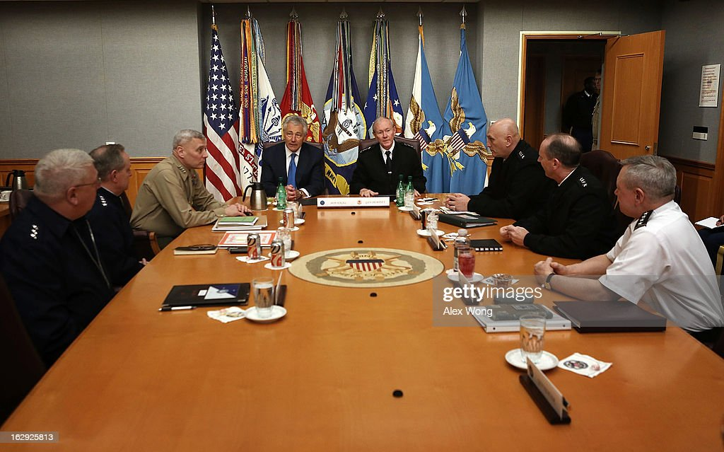 U.S. Secretary of Defense Chuck Hagel (4th L) meets with (L-R) Vice Commandant of the United States Coast Guard Vice Admiral John Currier, Air Force Chief of Staff General Mark Welsh, Marine Corps Assistant Commandant General John Paxton, Chairman of the Joint Chiefs of Staff General Martin Dempsey, Army Chief of Staff General Raymond Odierno, Chief of Naval Operations Admiral Jonathan Greenert, and Chief of the National Guard Bureau General Frank Grass at the Joint Chiefs Conference Room, also known as the 'tank,' March 1, 2013 at the Pentagon in Arlington, Virginia. Secretary Hagel participated in a meet-and-greet with the members of the Joint Chiefs of Staff.