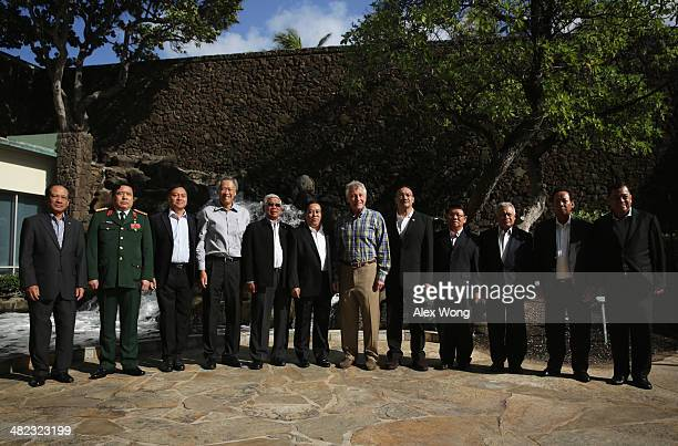 S Secretary of Defense Chuck Hagel participates in the official family photo during a meeting with his counterparts from southeastern Asia Secretary...