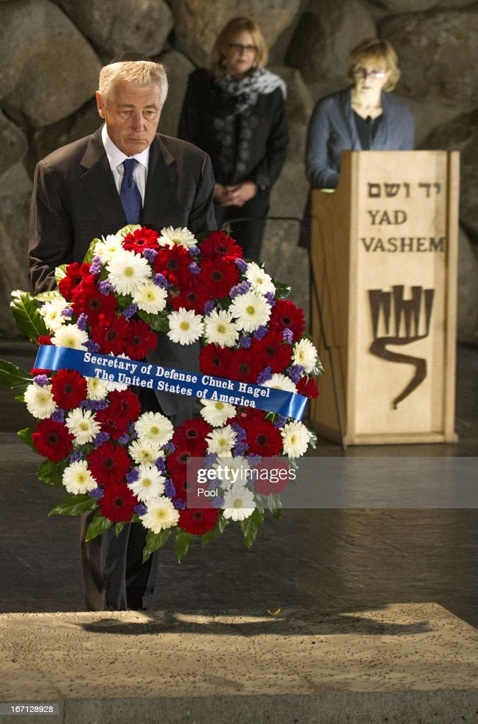 U.S. Secretary of Defense Chuck Hagel (L) places a wreath at the Hall of Remembrance as he tours Yad Vashem in Jerusalem, on April 21, 2013. Asked if a multi-billion dollar arms package with Israel was designed to convey a message that a military strike remains an option, Hagel said before landing in Tel Aviv: 'I don't think there's any question that's another very clear signal to Iran.'