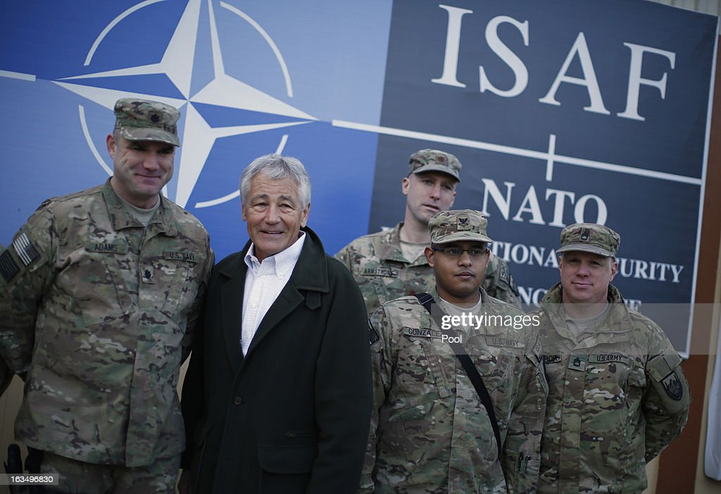 U.S. Secretary of Defense Chuck Hagel poses for a picture with members of the U.S. Navy and Army on March 11, 2013 in Kabul, Afghanistan. Hagel ended his three day visit to Afghanistan on Monday, his first as Secretary of Defense.