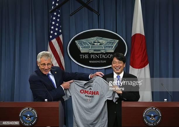 S Secretary of Defense Chuck Hagel presents Japanese Minister of Defense Itsunori Onodera with a tshirt from the University of Nebraska Omaha Hagel's...