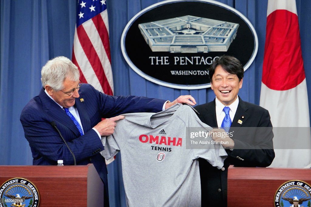 U.S. Secretary of Defense Chuck Hagel (L) presents Japanese Minister of Defense Itsunori Onodera (R) with a t-shirt from the University of Nebraska Omaha, Hagel's alma mater, during a joint news conference at the Pentagon July 11, 2014 in Arlington, Virginia. Onodera is on an eight-day visit in the U.S.