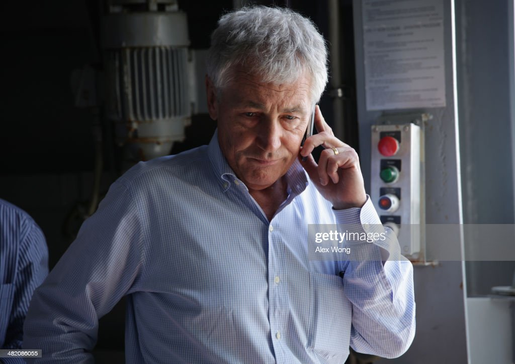 U.S. Secretary of Defense Chuck Hagel receives an update on the phone after a report of a shooting at Ft. Hood, Texas, while he is touring the the USS Anchorage (LPD-23), an amphibious transport dock ship, with his counterparts from Southeast Asia April 2, 2014 at Joint Base Pearl Harbor-Hickam in Honolulu, Hawaii. Secretary Hagel is in Hawaii to host a meeting of defense ministers from the Association of Southeast Asian Nations (ASEAN) on April 1 to 3.