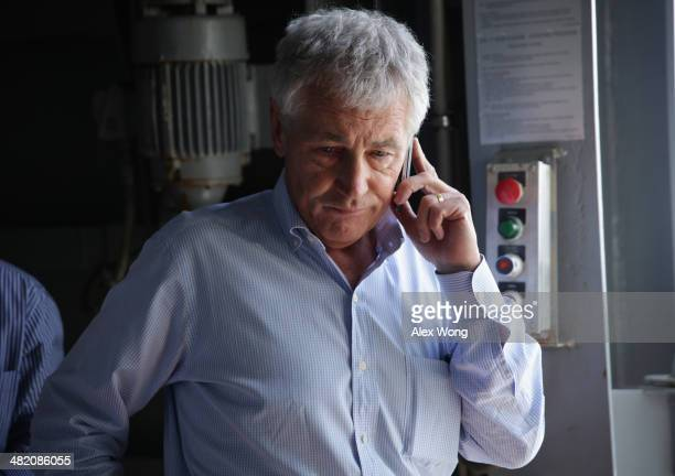 S Secretary of Defense Chuck Hagel receives an update on the phone after a report of a shooting at Ft Hood Texas while he is touring the the USS...