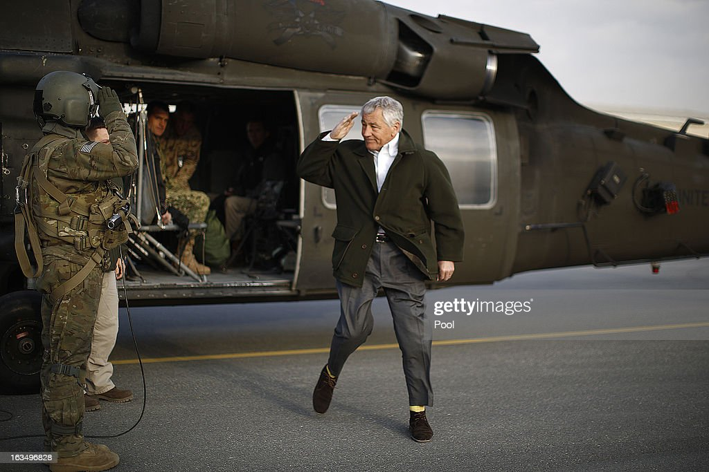 U.S. Secretary of Defense <a gi-track='captionPersonalityLinkClicked' href=/galleries/search?phrase=Chuck+Hagel&family=editorial&specificpeople=504963 ng-click='$event.stopPropagation()'>Chuck Hagel</a> returns a military salute as he steps off a blackhawk helicopter to transfer to an aircraft on his way to Washington on March 11, 2013 in Kabul, Afghanistan. Hagel ended his three day visit to Afghanistan on Monday, his first as Secretary of Defense.