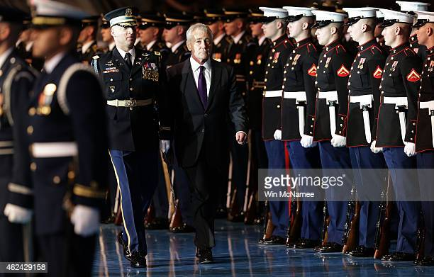 S Secretary of Defense Chuck Hagel reviews troops with Old Guard Commander Army Col Johnny Davis during a farewell ceremony for Hagel at Fort Myer...