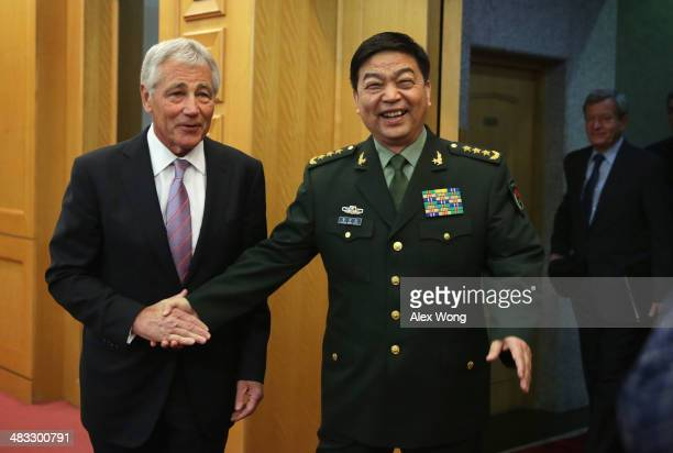 S Secretary of Defense Chuck Hagel shakes hands with Chinese Minister of Defense Chang Wanquan prior to their meeting at the Chinese Defense Ministry...