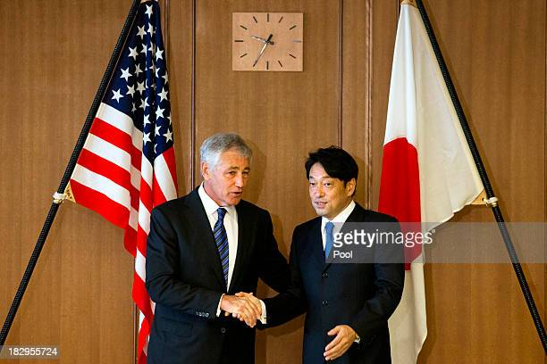 S Secretary of Defense Chuck Hagel shakes hands with Japanese Defense Minister Itsunori Onodera before their meeting at Defense Ministry on October 3...
