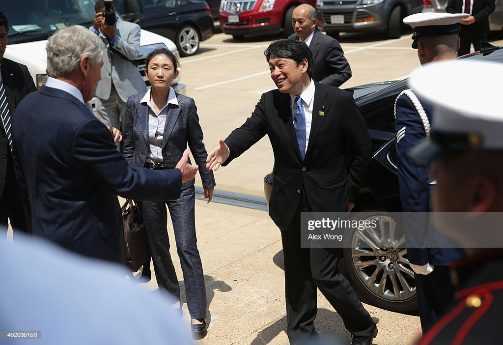 U.S. Secretary of Defense Chuck Hagel (L) shakes hands with Japanese Minister of Defense Itsunori Onodera (R) during an arrival at the Pentagon July 11, 2014 in Arlington, Virginia. Onodera is on an eight-day visit in the U.S.