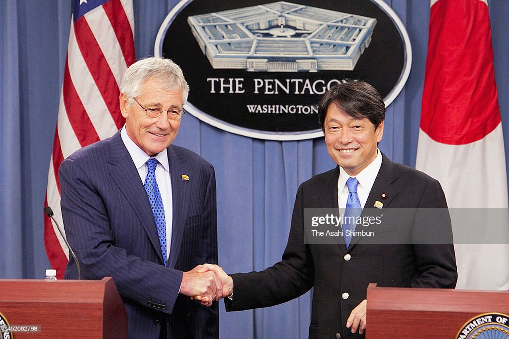 U.S. Secretary of Defense <a gi-track='captionPersonalityLinkClicked' href=/galleries/search?phrase=Chuck+Hagel&family=editorial&specificpeople=504963 ng-click='$event.stopPropagation()'>Chuck Hagel</a> (L) shakes hands with Japanese Minister of Defense <a gi-track='captionPersonalityLinkClicked' href=/galleries/search?phrase=Itsunori+Onodera&family=editorial&specificpeople=2547583 ng-click='$event.stopPropagation()'>Itsunori Onodera</a> (R) during a joint news conference at the Pentagon July 11, 2014 in Arlington, Virginia. Onodera is on an eight-day visit in the U.S.
