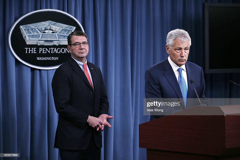U.S. Secretary of Defense <a gi-track='captionPersonalityLinkClicked' href=/galleries/search?phrase=Chuck+Hagel&family=editorial&specificpeople=504963 ng-click='$event.stopPropagation()'>Chuck Hagel</a> (R) speaks as Deputy Secretary of Defense <a gi-track='captionPersonalityLinkClicked' href=/galleries/search?phrase=Ashton+Carter&family=editorial&specificpeople=956792 ng-click='$event.stopPropagation()'>Ashton Carter</a> looks on during a news briefing March 1, 2013 at the Pentagon in Arlington, Virginia. Secretary Hagel spoke on the impact of the sequestration to the Department of Defense.