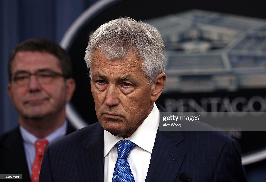 U.S. Secretary of Defense Chuck Hagel (R) speaks as Deputy Secretary of Defense Ashton Carter (L) looks on during a news briefing March 1, 2013 at the Pentagon in Arlington, Virginia. Secretary Hagel spoke on the impact of the sequestration to the Department of Defense.