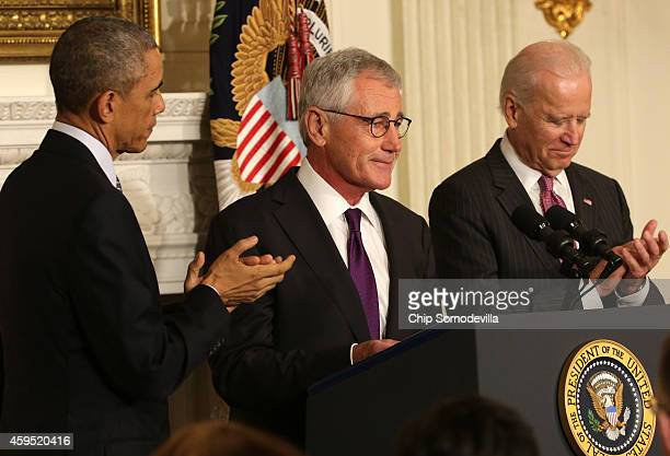 S Secretary of Defense Chuck Hagel speaks as President Barack Obama and Vice President Joe Biden look on during a press conference announcing Hagel's...