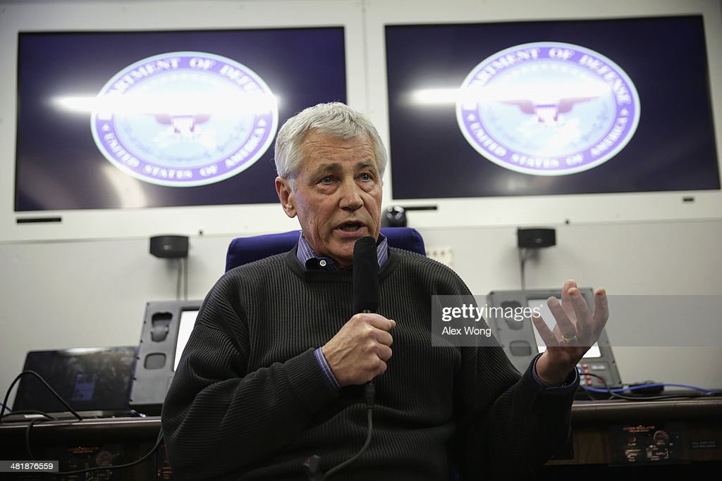 U.S. Secretary of Defense <a gi-track='captionPersonalityLinkClicked' href=/galleries/search?phrase=Chuck+Hagel&family=editorial&specificpeople=504963 ng-click='$event.stopPropagation()'>Chuck Hagel</a> speaks to members of a travel press pool April 1, 2014 en route Honolulu, Hawaii. Secretary Hagel is heading to Hawaii to host a meeting of defense ministers from the Association of Southeast Asian Nations (ASEAN) on April 1 to 3.