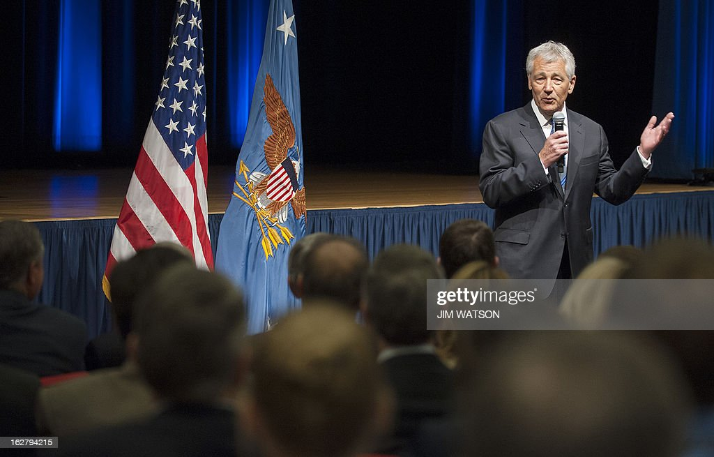 US Secretary of Defense Chuck Hagel speaks to service members and civilian employees during his first day at the Pentagon in Washington, DC, February 27, 2013. Hagel was sworn in Wednesday after a divisive Senate debate over his nomination that signals a rocky road ahead as he tackles deep budget cuts and frayed ties with Congress. Hagel, 66, took his oath of office at about 8:30 am (1330 GMT) at the Pentagon as his wife looked on, becoming the first combat veteran from the Vietnam conflict to take up the post. AFP PHOTO/Jim WATSON