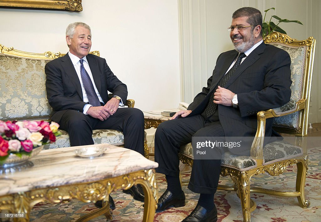 U.S. Secretary of Defense Chuck Hagel (L) speaks with Egyptian President Mohamed Morsi at the Presidential Palace on April 24, 2013 in Cairo, Egypt. The U.S. Defense Secretary is on a six-day regional tour of the Middle East, his first since taking over as Pentagon chief two months ago. The visit is expected to be dominated by concerns over Iran's nuclear program and Syria's civil war.