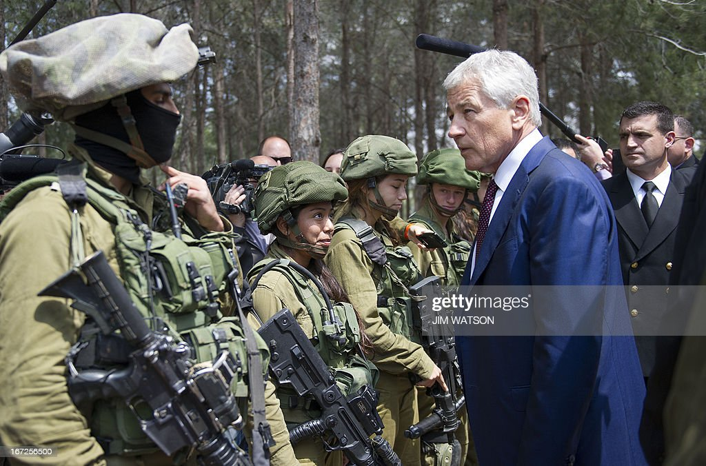 US Secretary of Defense Chuck Hagel speaks with Israeli soldiers during a visit to a military K-9 unit training site at an army base near Tel Aviv, on April 23, 2013. Defence Secretary Chuck Hagel met Israel's Benjamin Netanyahu at the end of a three-day trip which saw him touting strong backing for Israel despite differences over Iran's nuclear project.