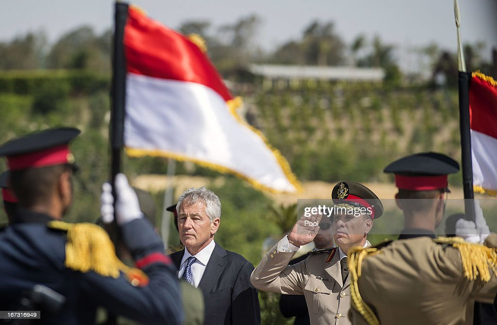 U.S. Secretary of Defense Chuck Hagel (2L) stands with an Egyptian army official as he salutes before laying a wreath at the Tomb of the Unknown Soldier on April 24, 2013 in Cairo, Egypt. The U.S. Defense Secretary is on a six-day regional tour of the Middle East, his first since taking over as Pentagon chief two months ago. The visit is expected to be dominated by concerns over Iran's nuclear program and Syria's civil war.