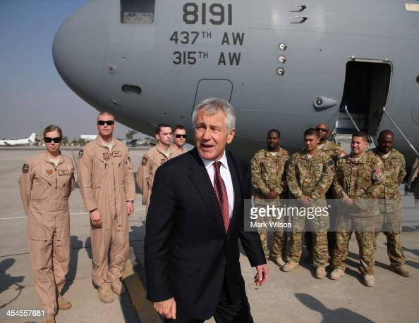 S Secretary of Defense Chuck Hagel stands with US troops before departing from the Islamabad International Airport December 9 2013 at Islamabad...