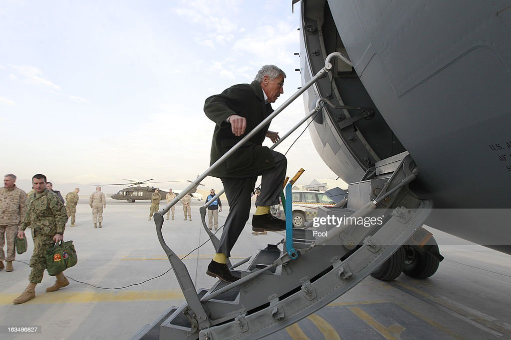 U.S. Secretary of Defense <a gi-track='captionPersonalityLinkClicked' href=/galleries/search?phrase=Chuck+Hagel&family=editorial&specificpeople=504963 ng-click='$event.stopPropagation()'>Chuck Hagel</a> steps aboard a C-17 military aircraft as he prepares to return to Washington on March 11, 2013 in Kabul, Afghanistan. Hagel ended his three day visit to Afghanistan on Monday, his first as Secretary of Defense.