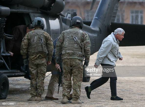 S Secretary of Defense Chuck Hagel steps off of a helicopter after arriving at the International Security Assistance Force Headquarters on December 7...