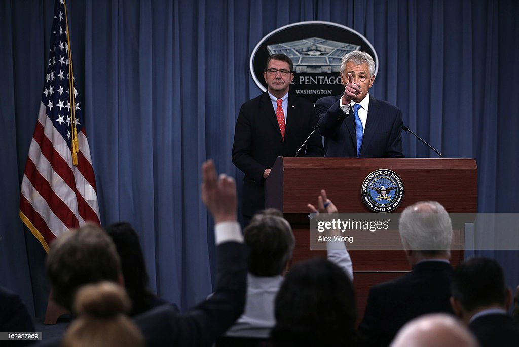 U.S. Secretary of Defense Chuck Hagel (R) takes questions as Deputy Secretary of Defense Ashton Carter (L) looks on during a news briefing March 1, 2013 at the Pentagon in Arlington, Virginia. Secretary Hagel spoke on the impact of the sequestration to the Department of Defense.