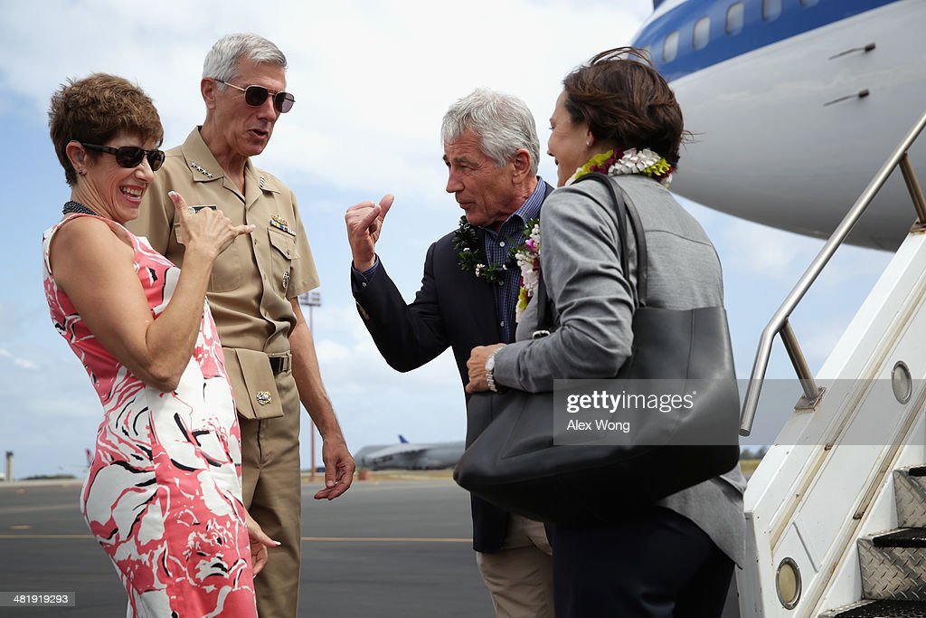 U.S. Secretary of Defense <a gi-track='captionPersonalityLinkClicked' href=/galleries/search?phrase=Chuck+Hagel&family=editorial&specificpeople=504963 ng-click='$event.stopPropagation()'>Chuck Hagel</a> (3rd L) throws a shaka sign after he and his wife Lilibet Hagel (R) were welcomed by Commander of U.S. Pacific Command Admiral Samuel Locklear (2nd L) and his wife Pamela Locklear (L) with a lei-greeting at Hickam Field of Joint Base Pearl Harbor April 1, 2014 in Honolulu, Hawaii. Secretary Hagel is in Hawaii to host a meeting of defense ministers from the Association of Southeast Asian Nations (ASEAN) on April 1 to 3.