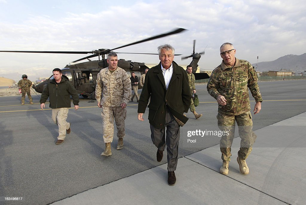 U.S. Secretary of Defense <a gi-track='captionPersonalityLinkClicked' href=/galleries/search?phrase=Chuck+Hagel&family=editorial&specificpeople=504963 ng-click='$event.stopPropagation()'>Chuck Hagel</a> walks from a blackhawk helicopter to his military transport aircraft on March 11, 2013 in Kabul, Afghanistan. Hagel ended his three day visit to Afghanistan on Monday, his first as Secretary of Defense.