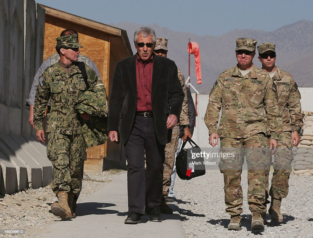 U.S. Secretary of Defense Chuck Hagel walks to meet with American troops during a visit, December 7, 2014 in FOB Gamberi, Afghanistan. Secretary Hagel visited the Forward Operating Base to meet with Afghanistan military officials and visit with American troops stationed there.