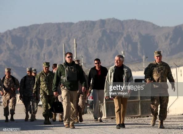 S Secretary of Defense Chuck Hagel walks to speak to US troops at the Kandahar air base on December 8 2013 in Kandahar Afghanistan Secretary Hagel...