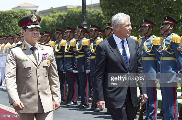 Secretary of Defense Chuck Hagel walks with Egyptian Defence Minister General Abdel Fattah alSissi during an arrival ceremony at the Ministry of...