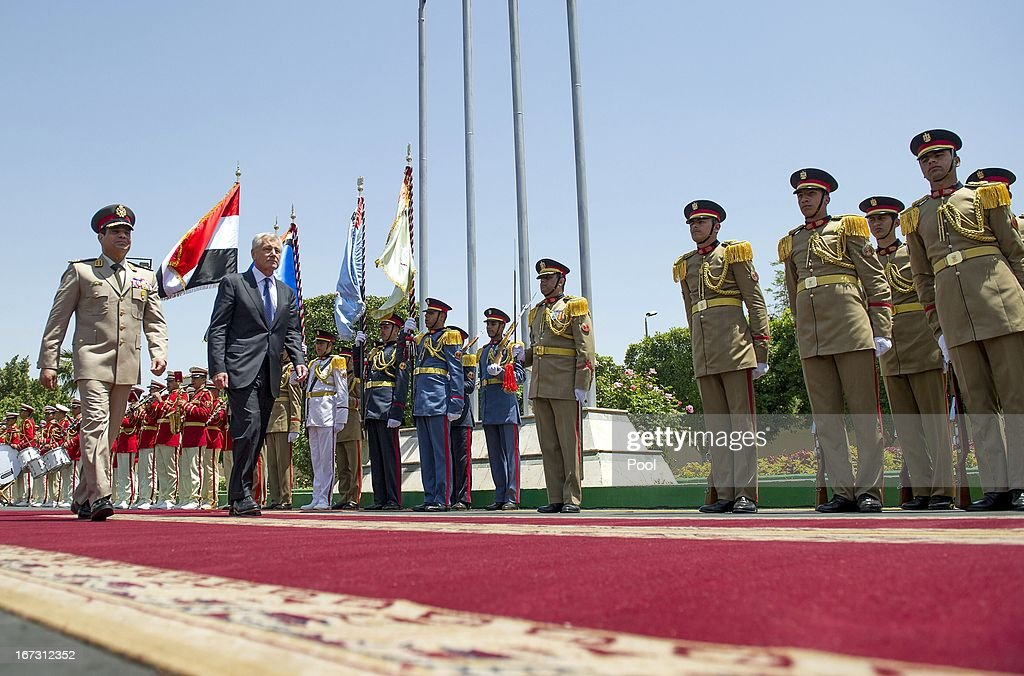 US Secretary of Defense Chuck Hagel (C) walks with Egyptian Defence Minister General Abdel Fattah al-Sissi during an arrival ceremony at the Ministry of Defense on April 24, 2013 in Cairo, Egypt. The US Defense Secretary is on a six-day regional tour of the Middle East, his first since taking over as Pentagon chief two months ago. The visit is expected to be dominated by concerns over Iran's nuclear programme and Syria's civil war.