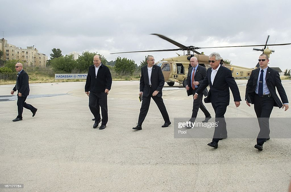 US Secretary of Defense Chuck Hagel walks with Israeli Minister of Defense Moshe Yaalon on a landing pad after a helicopter tour of Golan Heights on April 22, 2013 in Jerusalem, Israel. Hagel will visit Israel, Jordan, Saudi Arabia, Egypt and the United Arab Emirates on his first trip to the Mideast as Pentagon chief.