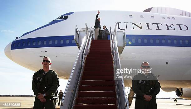 S Secretary of Defense Chuck Hagel waves as he boards his aircraft with his wife Lilibet April 1 2014 at Joint Base Andrews Maryland Hagel is heading...