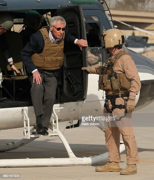 S Secretary of Defense Chuck Hagel wears body armor as he steps off a helicopter December 9 2014 at Baghdad Iraq During his visit Secretary Hagel met...
