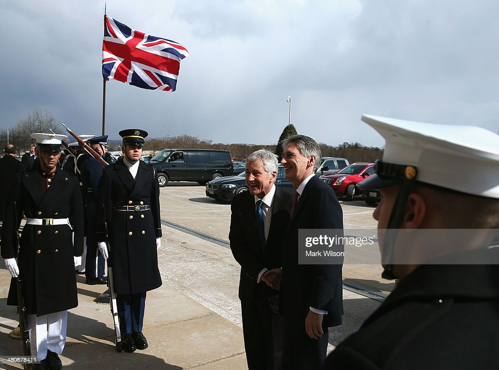 U.S. Secretary of Defense Chuck Hagel (L) welcomes United Kingdoms Secretary of State for Defense Philip Hammond after his arrival at the Pentagon on March 26, 2014 in Arlington, Virginia. Secretary Hagel and Secretary Hammond participated in news conference where they fielded questions about the situation in Ukraine.