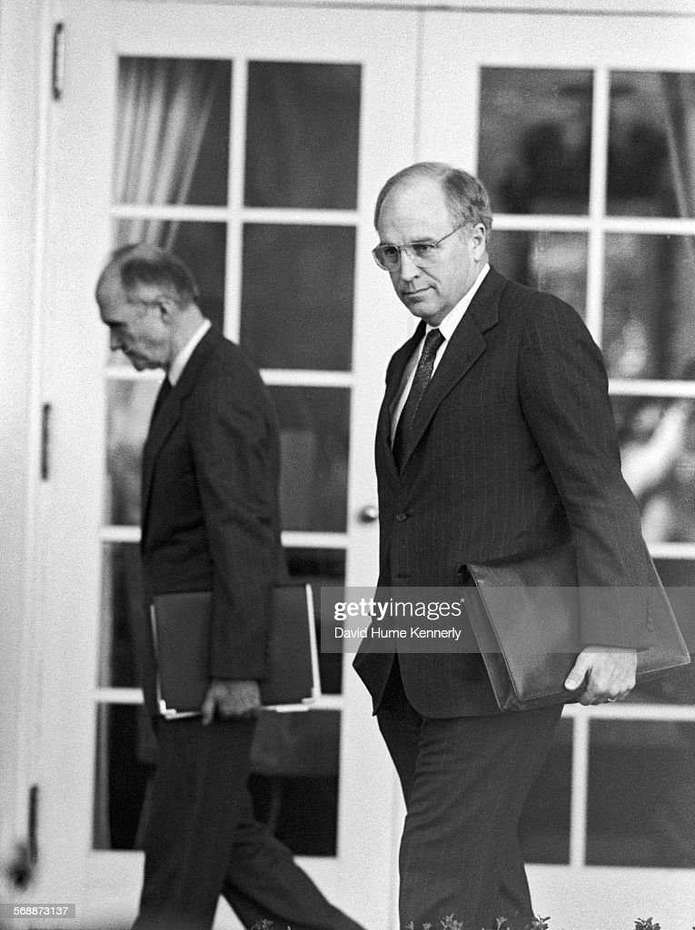 Secretary of Defense Dick Cheney and National Security Advisor Brent Scowcroft in the Rose Garden at the White House to talk about the visit of Cheney and Gen. Colin Powell who had just returned from the mideast prior to commencement of Desert Storm, the 1991 ground war with Iraq, February 11, 1991 in Washington, DC.