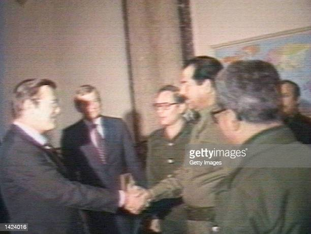 US Secretary of Defense Donald Rumsfeld and Iraqi President Saddam Hussein shake hands December 20 1983 in Baghdad Iraq Rumsfeld met with Hussein...