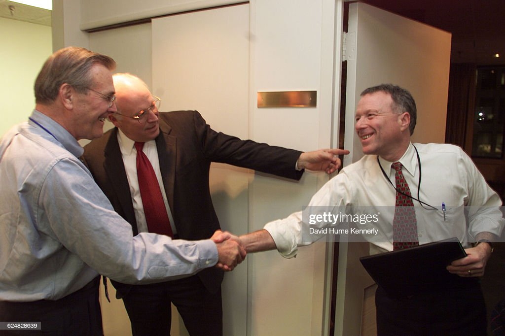 Secretary of Defense Donald Rumsfeld greets Scooter Libby and Vice Presidentelect Dick Cheney in December 2000 at the transition team headquarters...