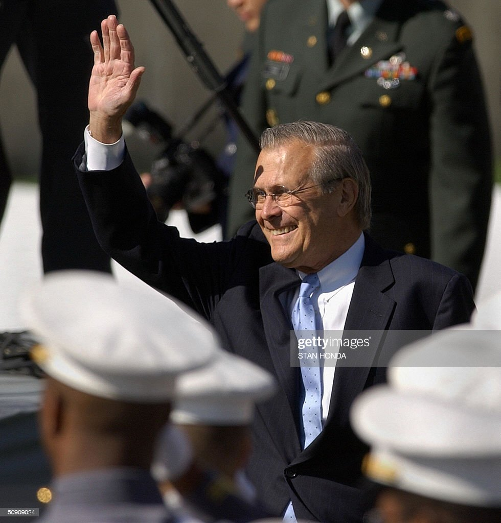 US Secretary of Defense Donald Rumsfeld waves before the 2004 graduating class of the US Military Academy 29 May 2004 at West Point, NY. While hailing the overthrow of regimes in Afghanistan and Iraq, Rumsfeld warned that the war on terror, launched in response to the 11 September 2001 attacks, would dominate the cadets' careers for years to come. AFP PHOTO/Stan HONDA