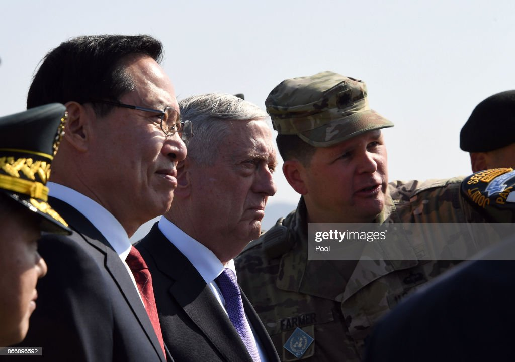 U.S. Secretary of Defense James Mattis (C) and South Korean Defense Minister Song Young-moo (L) visit Observation Post Ouellette near the truce village of Panmunjom in the Demilitarized Zone (DMZ) on October 27, 2017 in Panmunjom, South Korea. Mattis is in South Korea ahead of the visit by U.S. President Donald Trump.