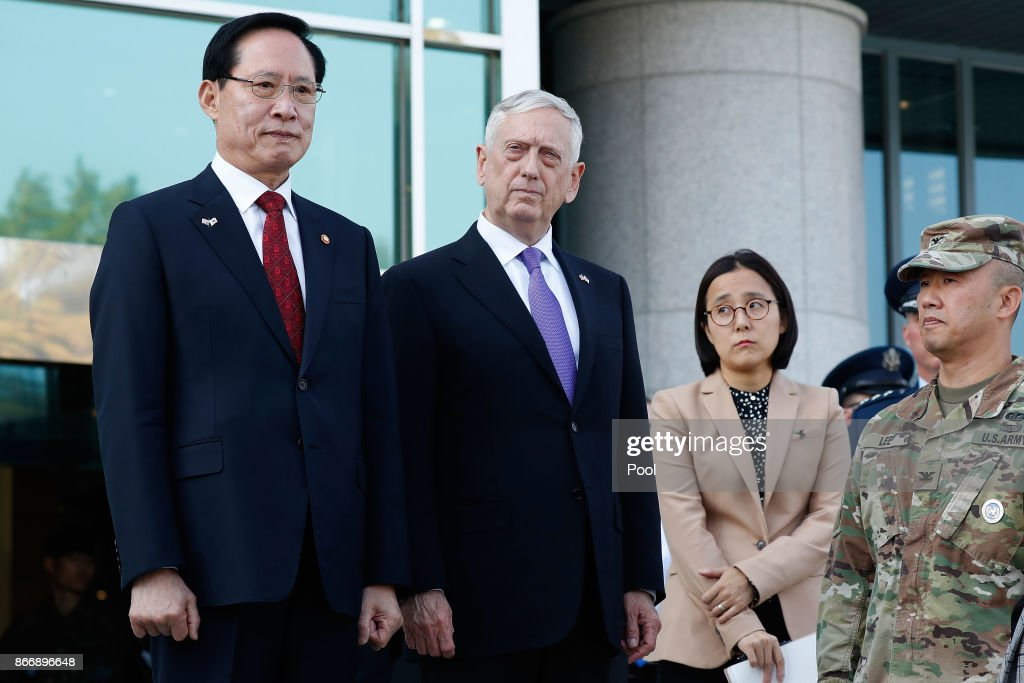 U.S. Secretary of Defense James Mattis (C) and South Korean Defense Minister Song Young-moo (L) visit at the truce village of Panmunjom in the Demilitarized Zone (DMZ) on October 27, 2017 in Panmunjom, South Korea. Mattis is in South Korea ahead of the visit by U.S. President Donald Trump.