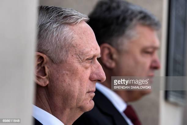 US Secretary of Defense James Mattis and Ukraine's President Petro Poroshenko listen to the US national anthem outside the Pentagon on June 20 2017...