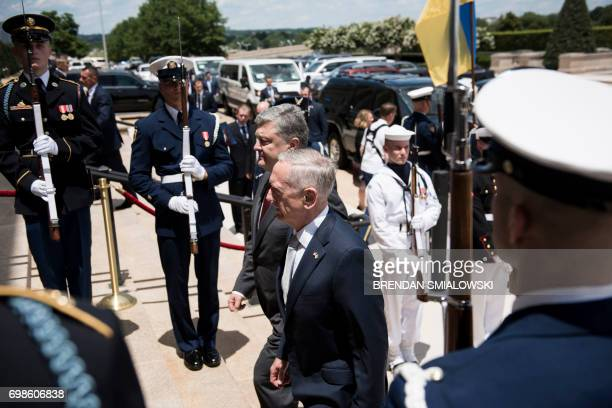 US Secretary of Defense James Mattis and Ukraine's President Petro Poroshenko walk into the Pentagon on June 20 2017 in Washington DC / AFP PHOTO /...