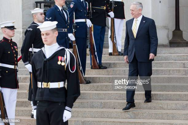 US Secretary of Defense James Mattis arrives for an honor cordon to welcome Finnish Minister of Defense Jussi Niinisto on March 21 2017 in Washington...