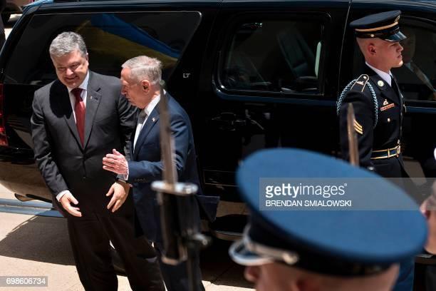 US Secretary of Defense James Mattis greets Ukraine's President Petro Poroshenko outside the Pentagon on June 20 2017 in Washington DC / AFP PHOTO /...