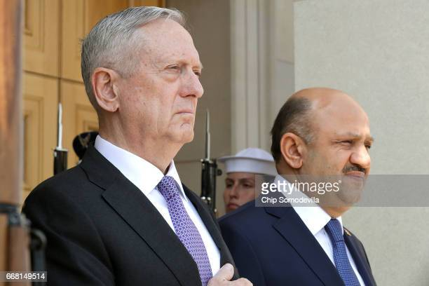 S Secretary of Defense James Mattis hosts an enhanced honor cordon welcoming Turkish Minister of National Defense Fikri Isik at the Pentagon April 13...