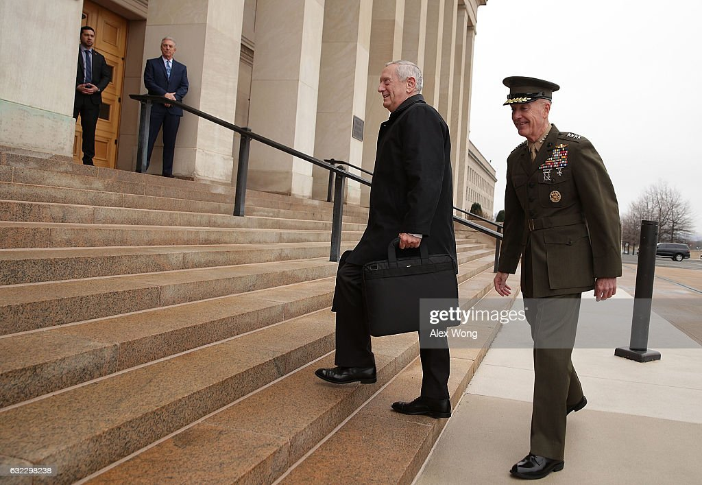 U.S. Secretary of Defense James Mattis (L) is greeted and escorted by Chairman of the Joint Chiefs of Staff General Joseph Dunford (R) as he arrives for the first day January 21, 2017 at the Pentagon in Arlington, Virginia. Retired General Mattis was confirmed as President Donald Trump's defense secretary by the Senate and sworn in by Vice President Mike Pence yesterday.