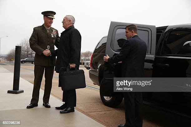 S Secretary of Defense James Mattis is greeted by Chairman of the Joint Chiefs of Staff General Joseph Dunford as he arrives for the first day...